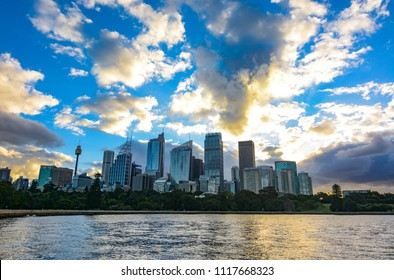 Amazing sunset over the Sydney central business district city skyline seen across the harbor