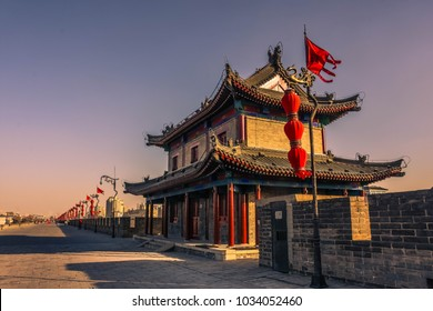 Amazing sunset over a temple on the Xi'An ancient city walls, China