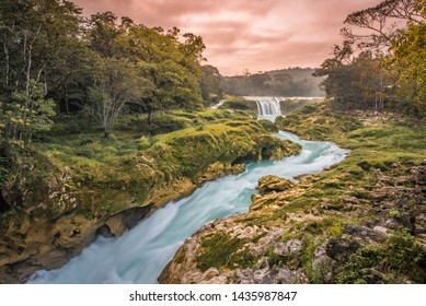 Amazing sunset over the turquoise waterfalls at Las Nubes in Chiapas, Mexico