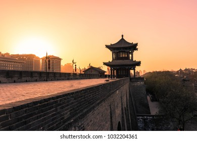 Amazing sunset over the Xi'An city walls and a temple, China
