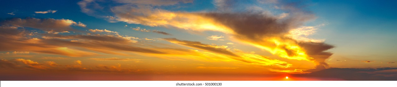 Amazing sunset panorama in a beautiful summer evening