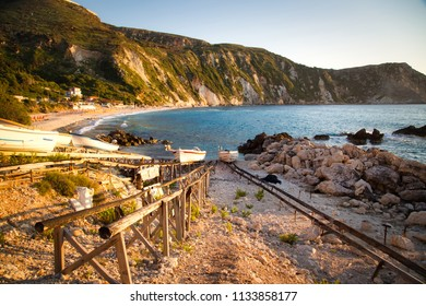 Amazing sunset panorama and boat racks of Petani beach, Kefalonia, Ionian Islands, Greece