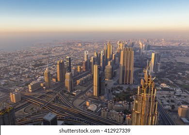 Amazing sunset and panoramic aerial view of Dubai city downtown in the United Arab Emirates in 2016