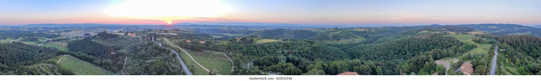 Amazing sunset panoramic aerial view of Tuscany hills in spring season - Italy.