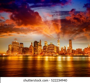 Amazing sunset panoramic skyline of Lower Manhattan as seen from Brooklyn Bridge Park, New York City.