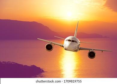amazing sunset and passenger plane
