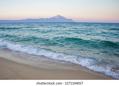 Amazing Sunset. The peninsula of Athos, includes Mount Athos, with the emerald blue sea in front. The beautiful beach in Sarti on Sithonia peninsula of Chalkidiki. The Aegean Sea. Nature background.