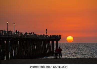 Amazing sunset scene of Hermosa Beach California. We can see amazing setting sun at Hermosa Beach Pier Los Angeles California.