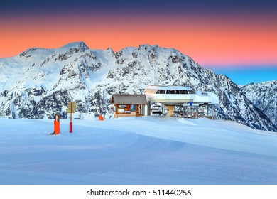 Amazing sunset and spectacular ski resort with cable car station,Alpe d Huez,France,Europe