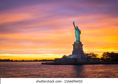 Amazing sunset sunrise, Statue of liberty over hudson river in new york city.