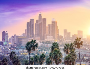 Amazing sunset view with palm tree and downtown Los Angeles. Cal