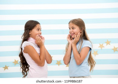 Amazing surprising news. Girls excited expression. Girls kids just heard amazing news. Surprised children excited about rumors. Secret little lies or gossips. Girlish gossip. Exciting rumor or news.