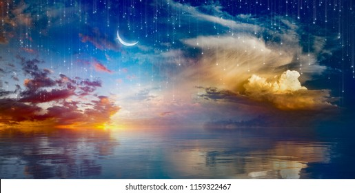 Amazing surreal background - crescent moon rising above serene sea in sunset sky, glowing horizon and falling stars.  Elements of this image furnished by NASA
