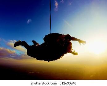 Amazing tandem jump sunset