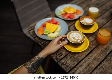 Amazing and tasty breakfast. Fruit plate? juice and delicious aromatic coffee. Morning breakfast or brunch with friend