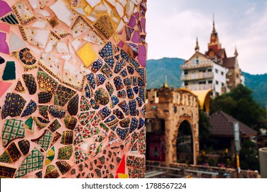 Amazing Thailand temple with scenery art mosaic glass on the wall. Popular famous landmark travel destination in Thailand. Asian culture and religion.