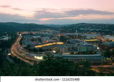 Amazing top view on Brno city, Czech republic at summer evening. Area around exhibition center, road, buildings, hotels, velodrome and houses. Breathtaking dark time with city lights.