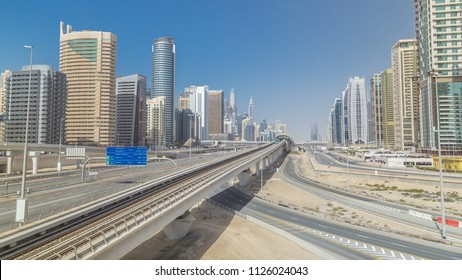 Amazing top view on Sheikh Zayed road surrounded Dubai Marina and JLT skyscrapers from bridge, Dubai. Traffic and metro line. United Arab Emirates