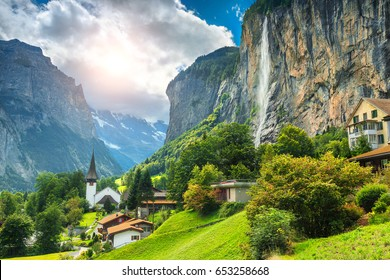 Amazing touristic alpine village with famous church and Staubbach waterfall, Lauterbrunnen, Switzerland, Europe