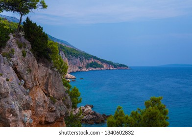 Amazing tranquille sea landscape with rocks and green trees