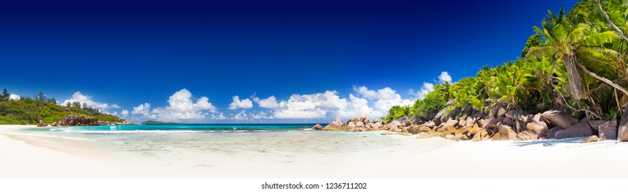 Amazing tropical beach Anse Cocos with granite boulders on La Digue Island, Seychelles