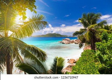 Amazing tropical beach Anse Patates with granite boulders on La Digue Island, Seychelles