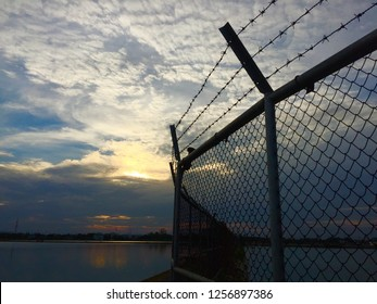 Amazing tropical -    Sunset, cloudy, sky, lagoon,  Steel Interlink Chain Wire Fence.