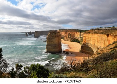 The amazing Twelve Apostles at sunset: a collection of limestone that stacks off the shore of the Port Campbell National Park, by the Great Ocean Road in Victoria, Australia.