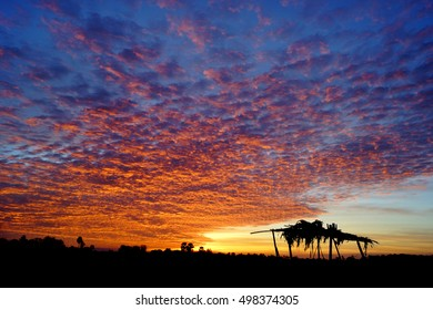 Amazing twilight sunset sky with a small shelter, Thailand