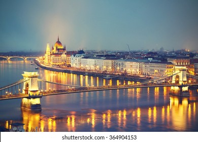 Amazing twilight with The Szechenyi Chain Bridge and Parliament in Budapest - vintage style