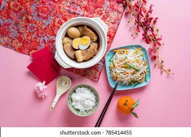 Amazing of Vietnamese food for Tet holiday in spring, it is traditional food on lunar new year: pork belly with hard-boiled eggs braised in coconut water, mixed pickles, rice