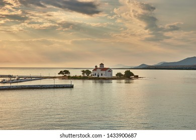 Amazing view of Agios Spyridon church in the picturesque Elafonisos village -island at sunset. Laconia, Peloponnese, Greece June