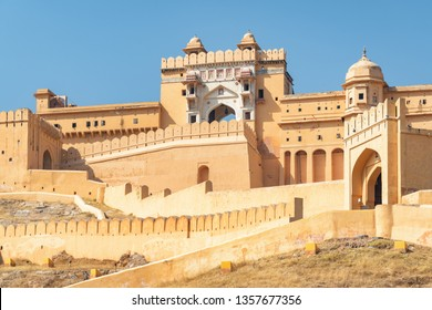 Amazing view of the Amer Fort and Palace (Amber Fort) on blue sky background in Jaipur, Rajasthan, India. Rajput military hill architecture. Jaipur is a popular tourist destination of South Asia.