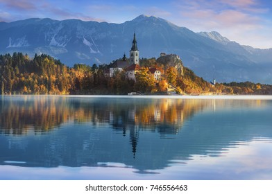 Amazing View in autumn  : Bled Lake, Island,Church And Castle With Mountain Range (Stol, Vrtaca, Begunjscica) In The Background-Bled,Slovenia,Europe