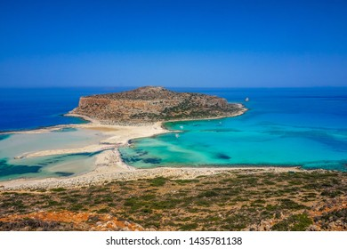 Amazing view of Balos Lagoon with turquoise waters, lagoons, tropical beaches of pure white sand and Gramvousa island on Crete, Greece, Europe