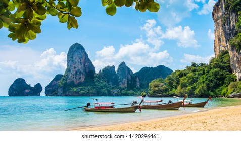 Amazing view of beautiful Ao Nang Beach with longtale boats. Location:  Krabi Province, Thailand, Andaman Sea. Artistic picture. Beauty world.