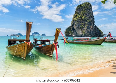 Amazing view of beautiful beach with longtale boats. Location: Railay beach, Krabi, Thailand, Andaman Sea. Artistic picture. Beauty world.