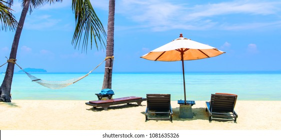 Amazing view of beautiful beach with palm trees, chaises and transparent turquoise water. A great place to relax. Location: Ko Phi Phi Don island, Krabi province, Thailand, Andaman Sea. Beauty world.