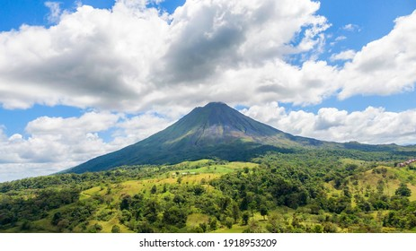 Amazing view of beautiful nature of Costa Rica with smoking volcano Arenal background. Panorama of volcano Arenal, La Fortuna, Costa Rica. Central America.
