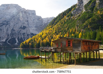 Amazing view of Braies Lake - Lago di Braies - with autumn forest and mountains reflected in surface lake water Dolomites Alps, Italy, Europe
