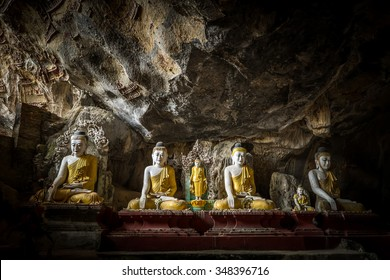 Amazing view of lot Buddhas statues and religious carving on limestone rock in sacred Kaw Goon cave. Hpa-An, Myanmar (Burma) travel landscapes and destinations
