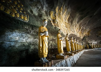 Amazing view of lot Buddhas statues and religious carving on limestone rock in sacred Sadan Sin Min cave. Hpa-An, Myanmar (Burma) travel landscapes and destinations