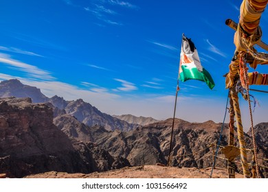 Amazing view of a canyon with the Jordan flag and blue sky, Petra, Wadi Musa, 2018