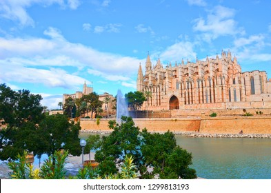 Amazing view of the Cathedral of Santa Maria of Palma and the Royal Palace of La Almudaina in spanish Palma, Mallorca in winter. The city is popular by tourists mainly for these two beautiful sites.