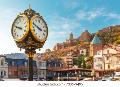 Amazing view of City clock, Old Meidan Square and Narikala ancient fortress in the sunny morning, Tbilisi, Georgia.