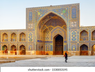 Amazing view of courtyard of the Shah Mosque (Imam Mosque) in Isfahan, Iran. Walls and arches covered with colorful mosaic tiles. Persian exterior of the Muslim place. Awesome Islamic architecture.