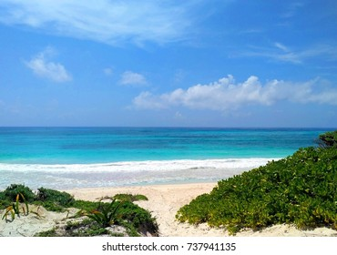 Amazing view of crystal clear turquoise Caribbean Sea and beautiful empty white sand beach with green tropical plants in Xpu-Ha, Riviera Maya, Mexico – exotic holiday in paradise