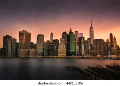 Amazing view of downtown Manhattan and skyline taken during beautiful and colorful sunset from Brooklyn area, New York city, New York, USA.
