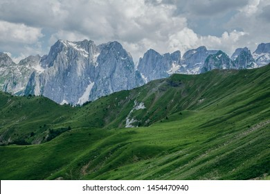Amazing view of green valley with mountains on background and cloudy sky. Prokletije National Park, Montenegro