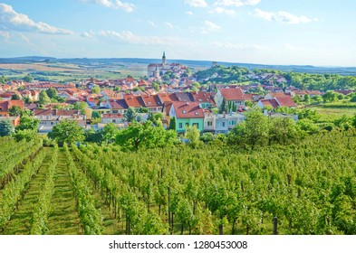 Amazing view of green vineyards and the historical city of Mikulov in the Czech Republic taken on a sunny summer day. This beautiful town is located in Moravia region which is known for wine growing.